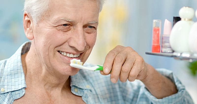 How can I help with an older person's oral hygiene?